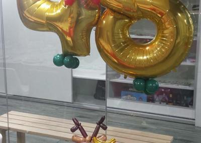 Bouquet cumpleaños con figura reno.
